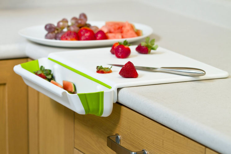 Counter-edge-cutting-board-with-collapsible-scrap-bin