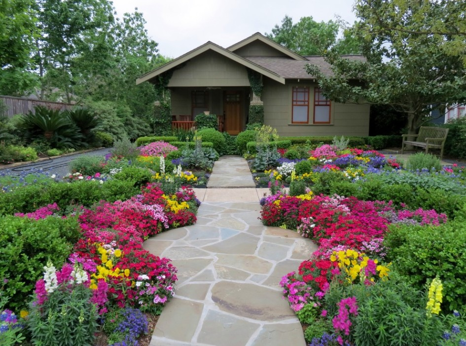 front-yard-landscape-with-slate-stone-entry-pathway-surrounded-with-colorful-garden-945x701